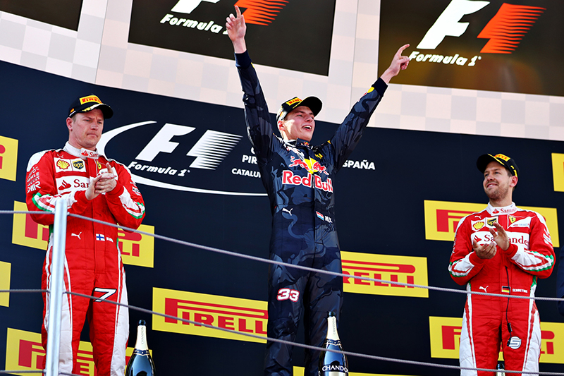 Max Verstappen of Netherlands and Red Bull Racing celebrates his first F1 win on the podium with Kimi Raikkonen of Finland and Ferrari and Sebastian Vettel of Germany and Ferrari during the Spanish Formula One Grand Prix