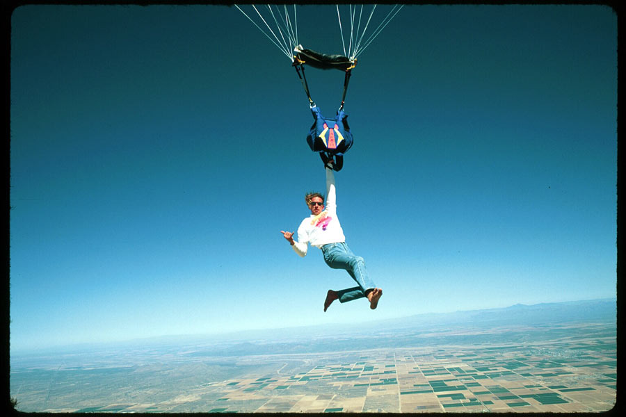 manliest photos on the internet, funny manly images, stuntman greg gasson hanging from parachute harness