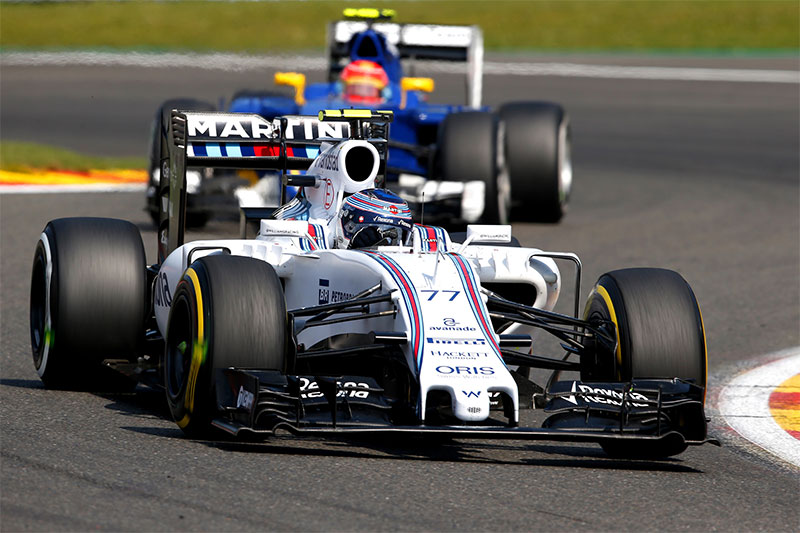Valtteri Bottas drives during the 2015 Belgian Grand Prix with mismatched tires.