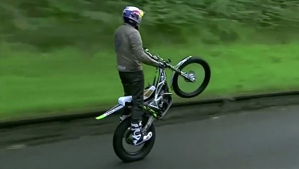 Dougie Lampkin wheelies through the Isle of Man