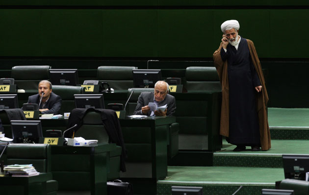 A cleric uses his smartphone in the Iranian parliament