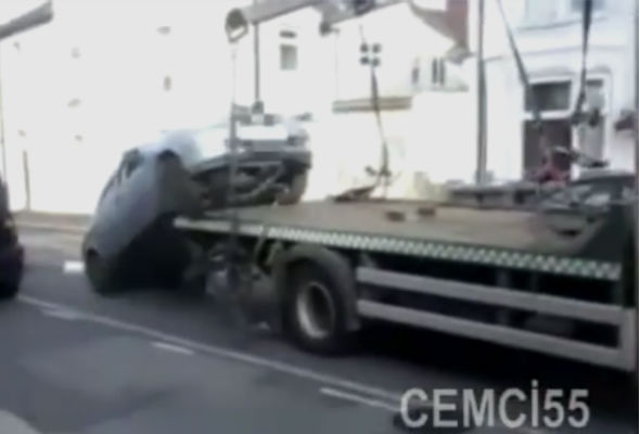 Motorist drives car off lorry