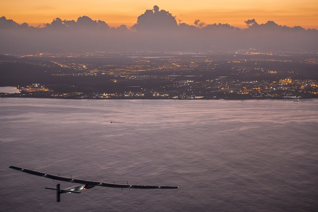 Hawaii, United States of America, June 28, 2015: Solar Impusle 2 lands in Hawaii  with Andr� Borschberg at the controls. The First Round-the-World Solar Flight will take 500 flight hours and cover 35�000 km, over five months. Swiss founders and pilots, Bertrand Piccard and Andr� Borschberg hope to demonstrate how pioneering spirit, innovation and clean technologies can change the world. The duo will take turns flying Solar Impulse 2, changing at each stop and will fly over the Arabian Sea, to India, to Myanmar, to China, across the Pacific Ocean, to the United States, over the Atlantic Ocean to Southern Europe or Northern Africa before finishing the journey by returning to the initial departure point. Landings will be made every few days to switch pilots and organize public events for governments, schools and universities.