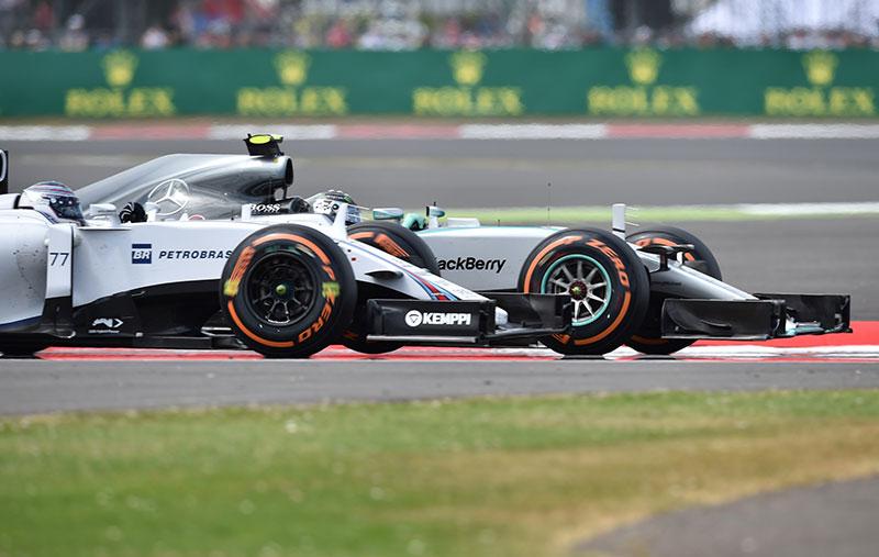 Nico Rosberg passes Valtteri Bottas at the 2015 British Grand Prix.