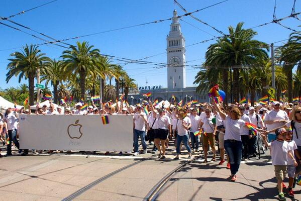 Photo of Apple's workers participating in the 2014 Pride parade