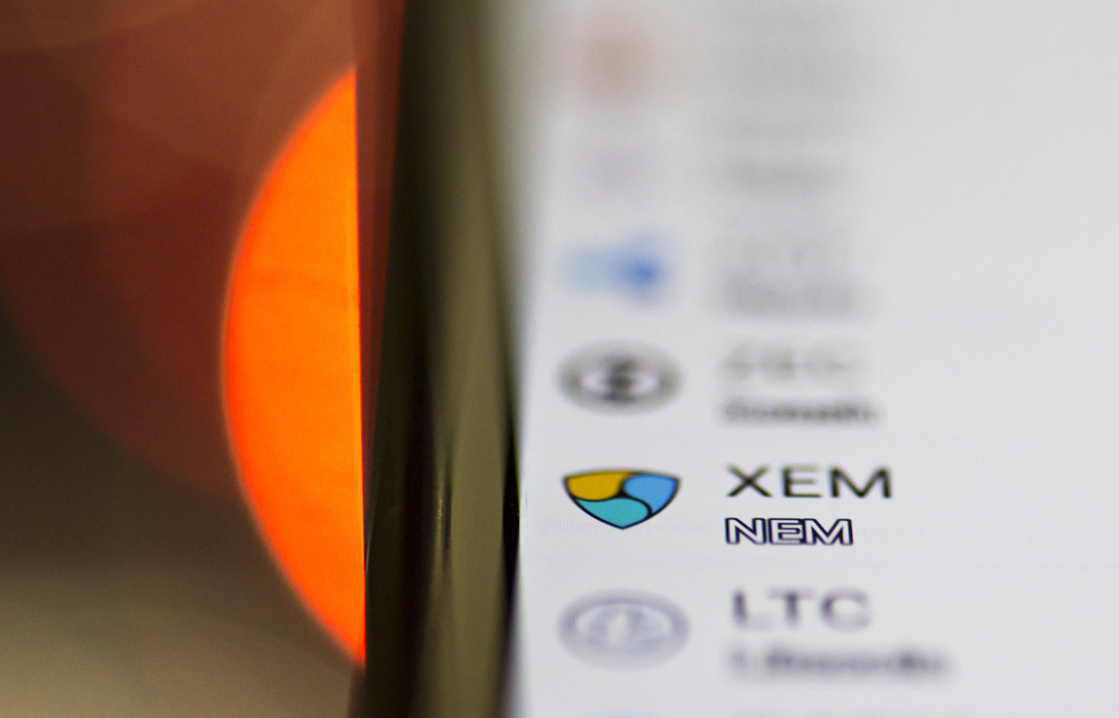 TOKYO, JAPAN - JANUARY 29: The logo of the NEM virtual currency is seen on Coincheck's cryptocurrency wallet app in this arranged photograph on January 29, 2018 in Tokyo, Japan. The Financial Services Agency (FSA) of Japan said it issued an improvement order to Coincheck, one of Japanese cryptocurrency exchanges, on January 29, 2018 after NEM coins worth 58 billion yen (approx 655 million USD) were stolen from the exchange on Friday January 26, 2018.  (Photo by Tomohiro Ohsumi/Getty Images)