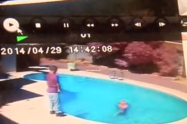 Dad throws two-year-old daughter into swimming pool to teach her a lesson (video)