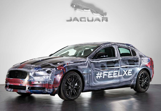 Jaguar XE in camouflage, front three-quarter view.