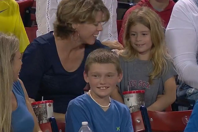 Kind boy, 12, hands treasured baseball to young girl in crowd