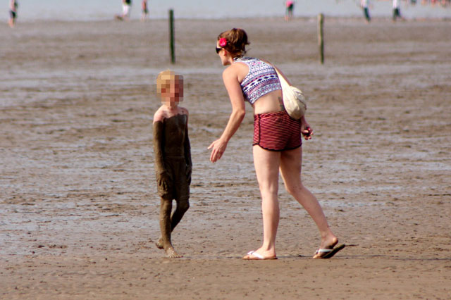 Up to his neck in it! Muddy boy gets stern telling off from furious mum