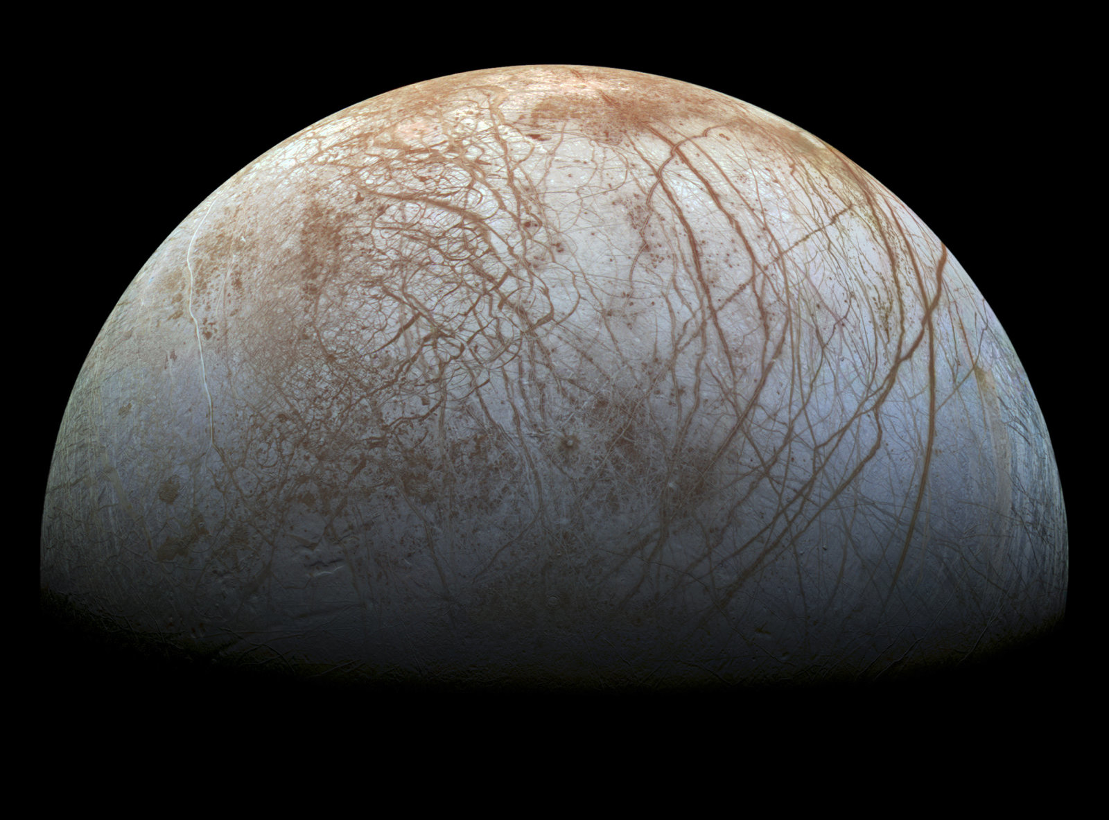 A new mosaic made from images taken by NASA's Galileo spacecraft in the late 1990's is shown of the surface of Jupiter's icy moon, Europa, as it looms large in this newly-reprocessed, higher resolution color view in this handout provided by NASA November 24, 2014. This newer version was created from images assembled into a realistic color view of the surface that approximates how Europa would appear to the human eye. NASA/JPL-Caltech/SETI Institue/Handout via Reuters   (OUTERSPACE - Tags: SCIENCE TECHNOLOGY)ATTENTION EDITORS - FOR EDITORIAL USE ONLY. NOT FOR SALE FOR MARKETING OR ADVERTISING CAMPAIGNS. THIS PICTURE WAS PROVIDED BY A THIRD PARTY. REUTERS IS UNABLE TO INDEPENDENTLY VERIFY THE AUTHENTICITY, CONTENT, LOCATION OR DATE OF THIS IMAGE. THIS PICTURE IS DISTRIBUTED EXACTLY AS RECEIVED BY REUTERS, AS A SERVICE TO CLIENTS