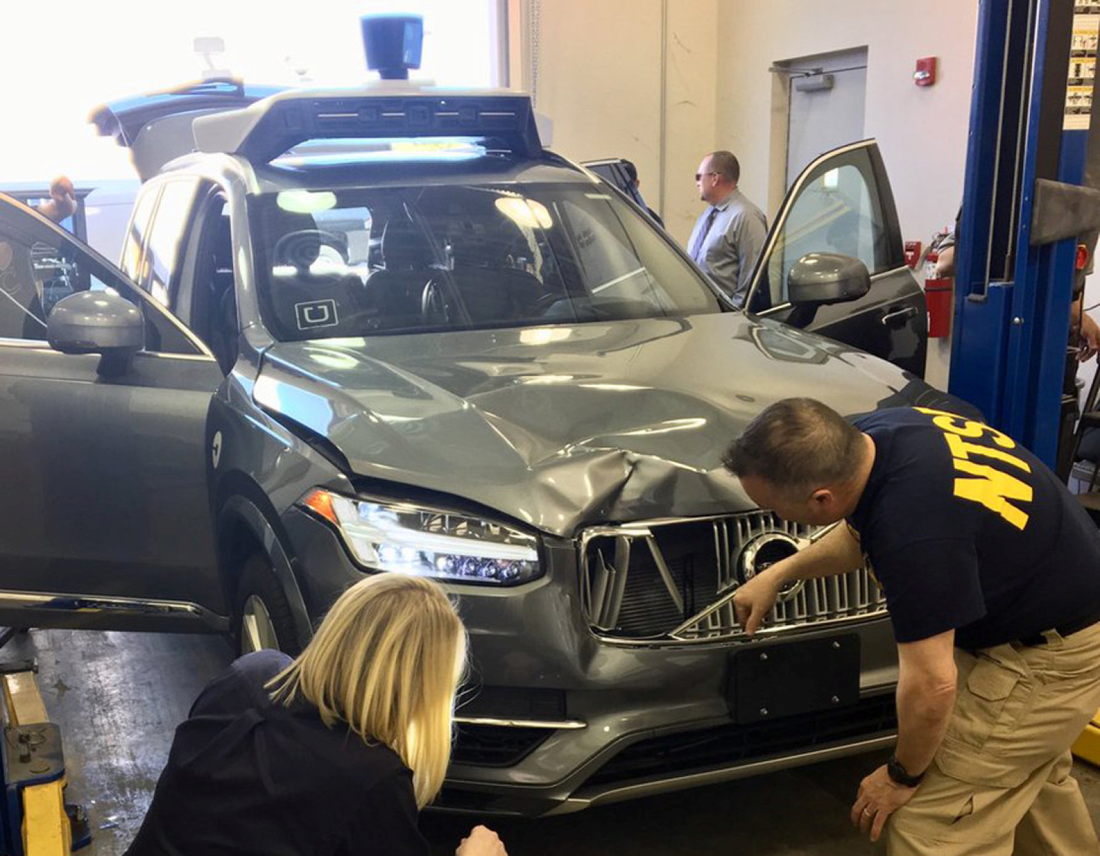 National Transportation Safety Board (NTSB) investigators examine a self-driving Uber vehicle involved in a fatal accident in Tempe, Arizona, U.S., March 20, 2018.  A women was struck and killed by the vehicle on March 18, 2018.  National Transportation Safety Board/Handout via REUTERS   ATTENTION EDITORS - THIS IMAGE WAS PROVIDED BY A THIRD PARTY.