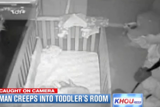 Caught on camera: Burglar creeps round sleeping toddler