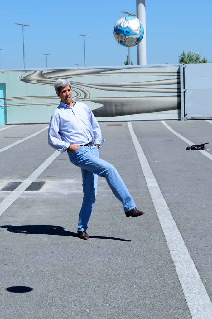 John Kerry kicking a soccer ball