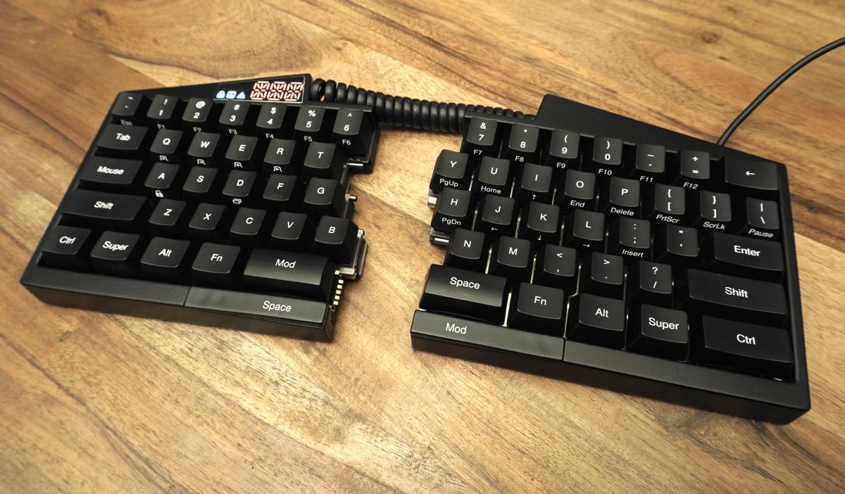 Ultimate Hacking Keyboard splits in half, is fully programmable