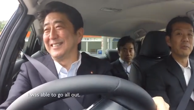Japanese Prime Minister Shinzo Abe drives the Toyota fuel-cell vehicle