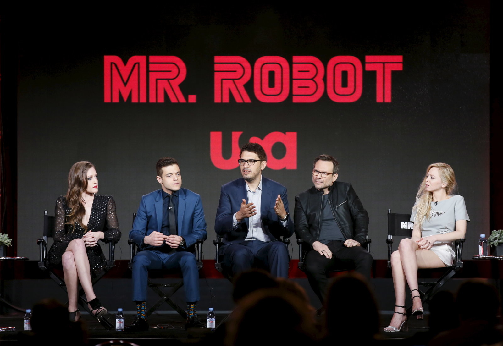 """Creator and executive producer Sam Esmail (C) speaks on stage with cast members Carly Chaikin, Rami Malek, Christian Slater and Portia Doubleday (L-R) during a panel for the USA Network series """"Mr. Robot"""" during the Television Critics Association (TCA) Cable Winter Press Tour in Pasadena, California, January 14, 2016. REUTERS/Danny Moloshok"""