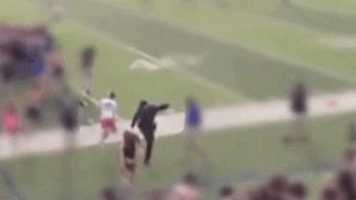 jerk cop trips students rushing field