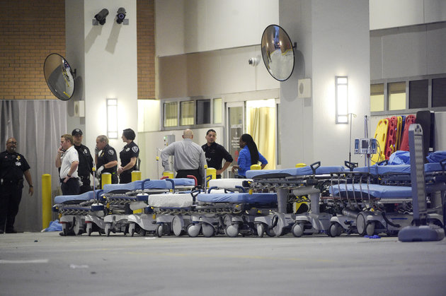 Emergency personnel wait with stretchers at the emergency entrance to Orlando Regional Medical Center hospital for the arrival of patients from the scene of a fatal shooting at Pulse Orlando nightclub in Orlando, Fla., Sunday, June 12, 2016. (AP Photo/Phelan M. Ebenhack)