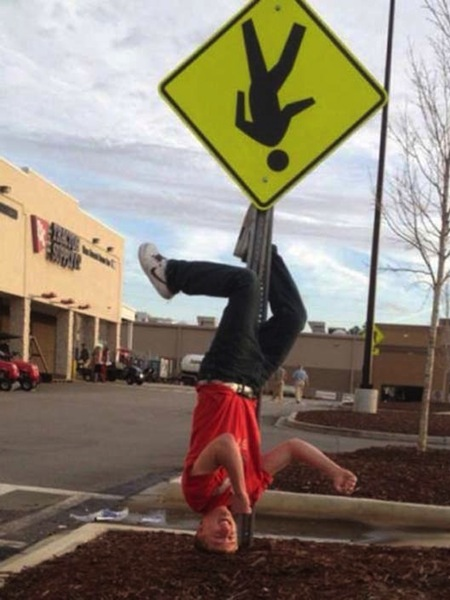 people obeying signs to a fault, funny acting out signs, upside down walk sign