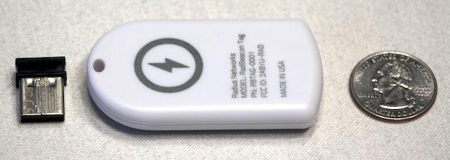 Radius Networks RadBeacon USB and RadBeacon Tag with a quarter for size comparison