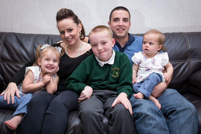 Adam McQuillan, 11, back at school after months in a coma