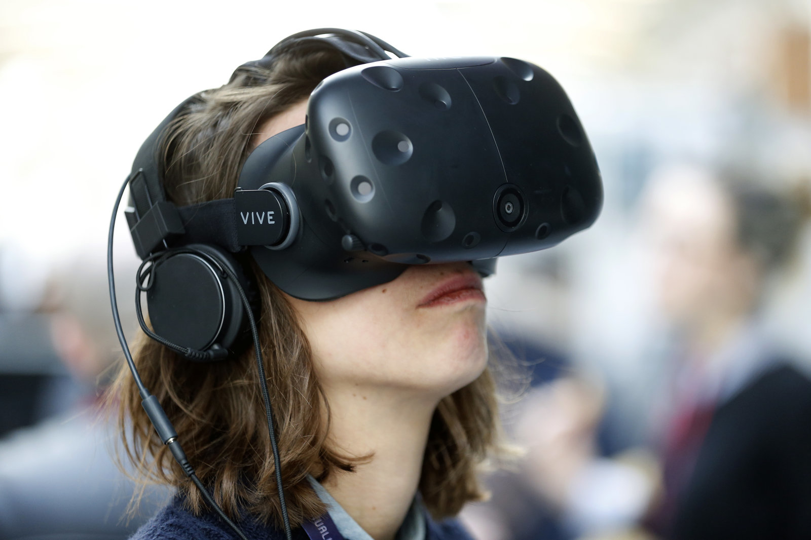 PARIS, FRANCE - FEBRUARY 08:  An visitor wears a Vive virtual reality (VR) headset, manufactured by HTC Corp during the 'Virtuality Paris 2018' show on February 08, 2018 in Paris, France. The second edition of Virtuality Paris, the virtual reality fair, will be held in Paris from 08 to 10 February 2018  (Photo by Chesnot/Getty Images)