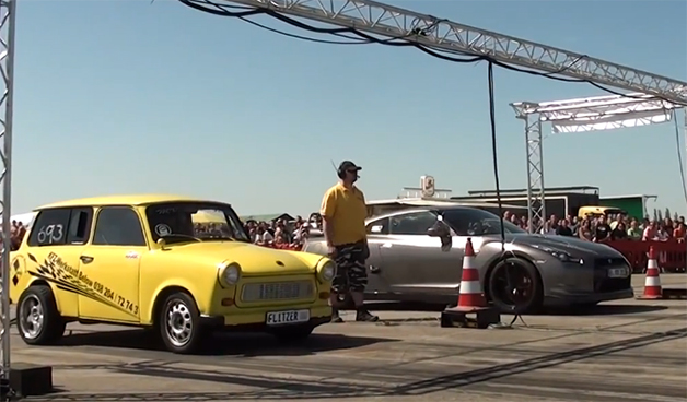 Screencap from a drag race between modified Trabant and a Nissan GT-R