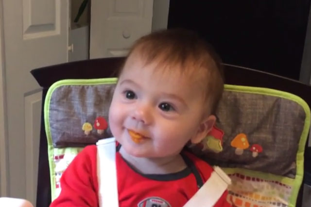 Baby's first taste of food (video)