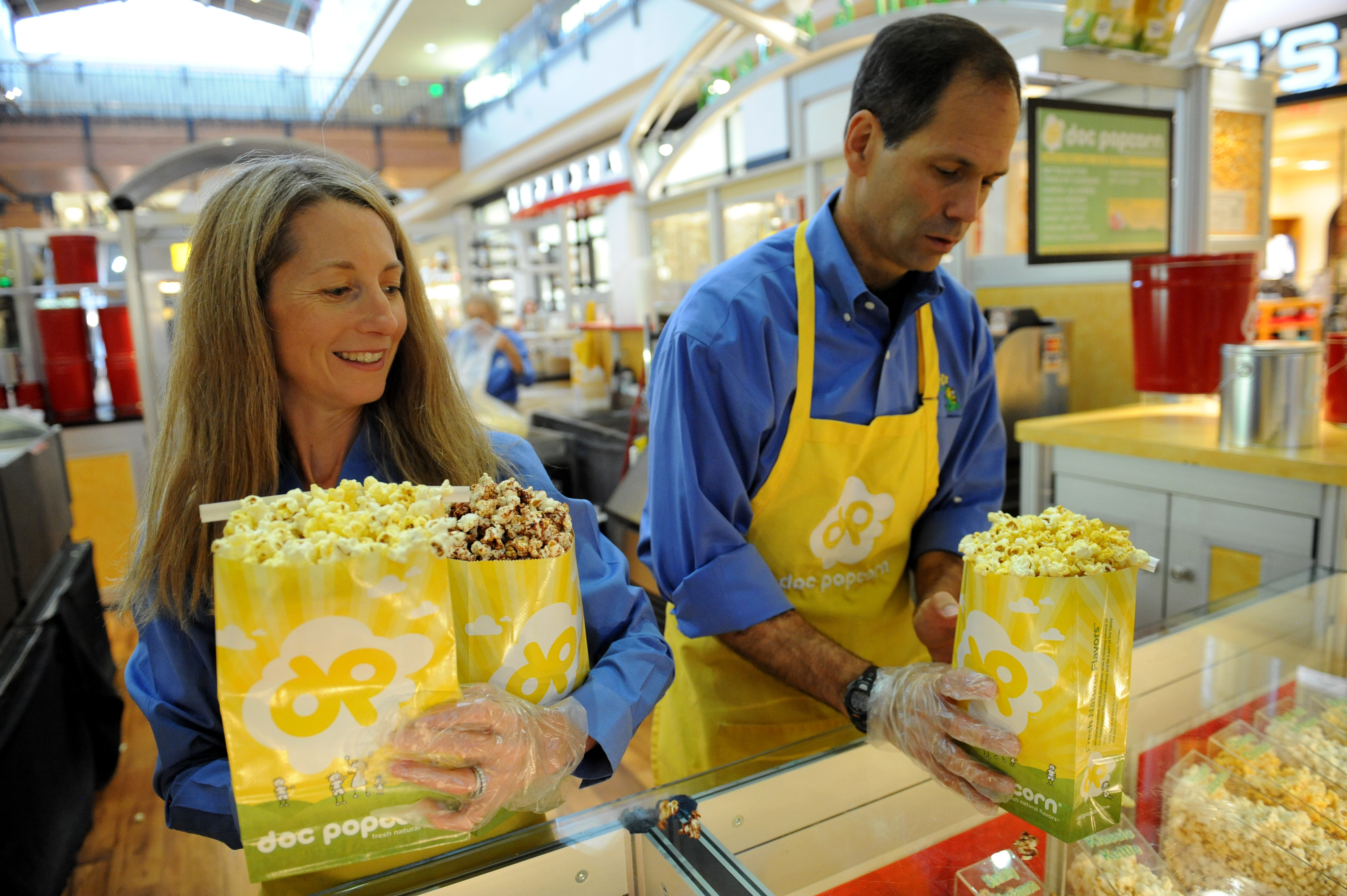 Founders and owners of Doc Popcorn Renee Israel, left and her husband Rob Israel, are shown at their popcorn stand at Flatirons Mall in Broomfield. Their local company, which they say was started in Boulder, is now in 22 other states. Helen H. Richardson, The Denver Post  (Photo By Helen H. Richardson/The Denver Post via Getty Images)