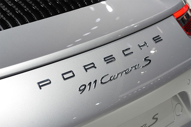 The badge on the hood cover of the 2016 Porsche 911.