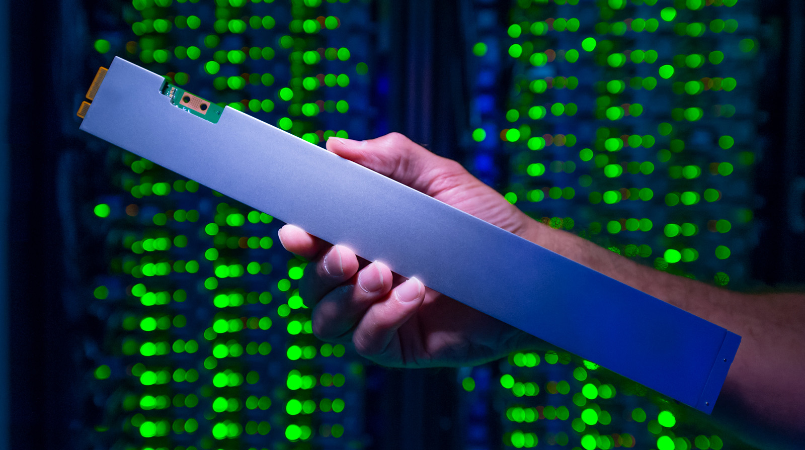 The ruler-shaped Intel SSD DC P4500 can hold up to 32 terabytes. It draws just one-tenth the power of a traditional spinning hard drive. (Credit: Walden Kirsch/Intel Corporation)