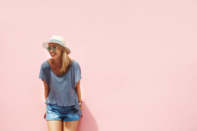 woman-in-sunglasses-pink-wall