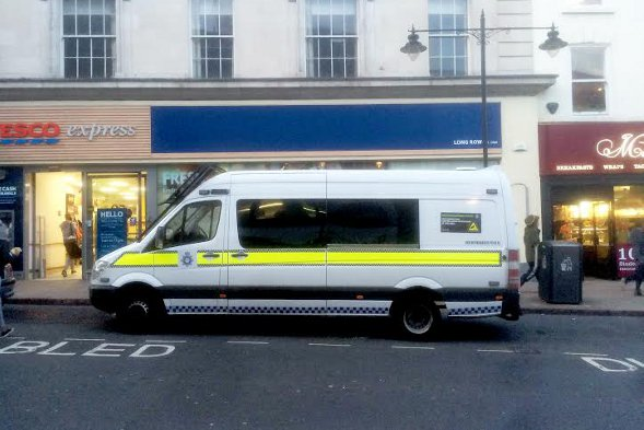The police van parked in a disabled bay.