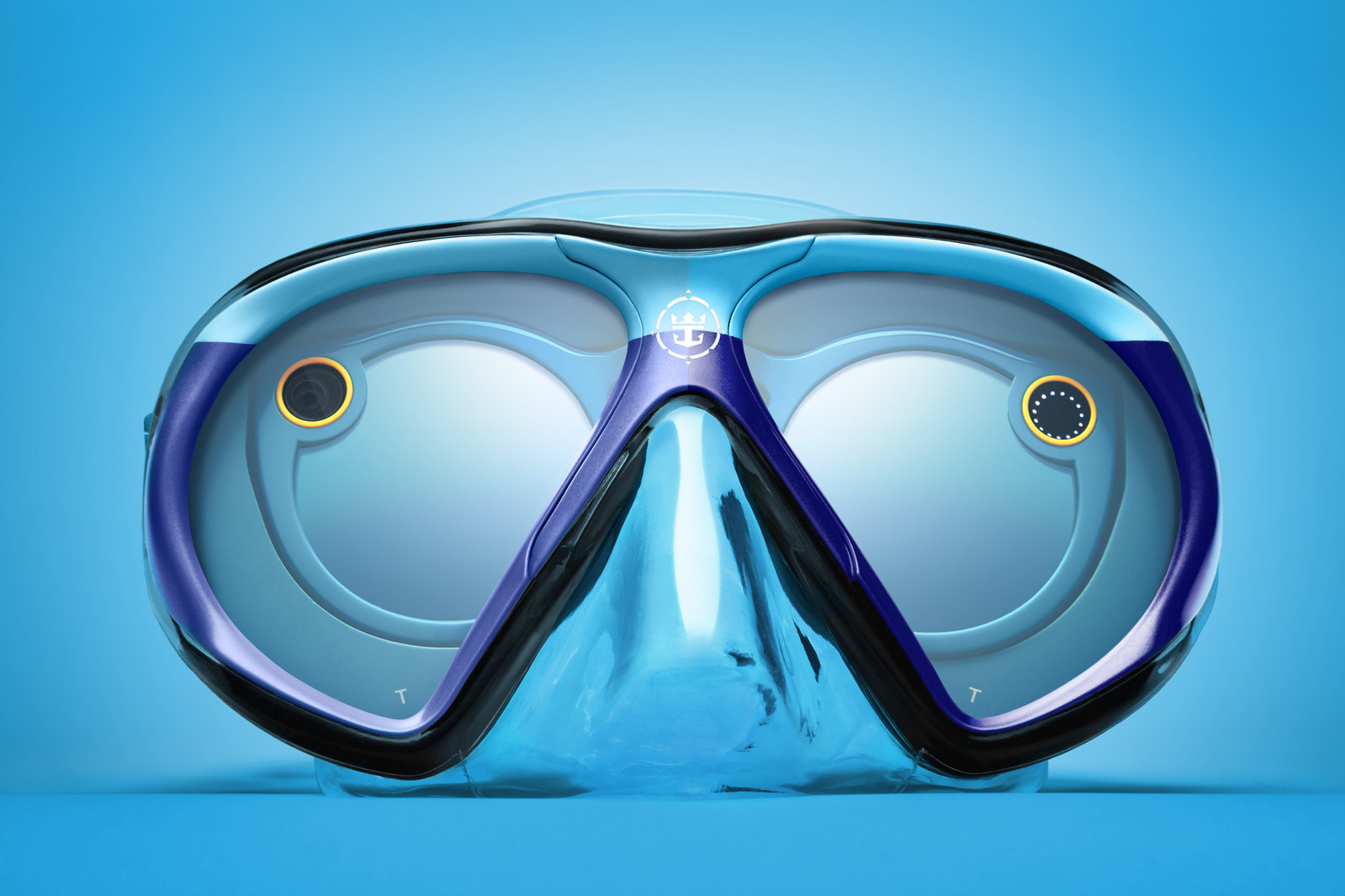 From June 21 to June 25, Royal Caribbean�s Snapchat channel will immerse viewers in a one of-a-kind underwater adventure thanks to a custom-designed scuba mask dubbed �SeaSeekers.� The mask was custom engineered by the cruise line for use with Snapchat Spectacles. It allows the wearer to snap while underwater and will give those above the surface a unique perspective into the intriguing underwater world of marine life. Fans can #SeekDeeper by following @RoyalCaribbean on Snapchat. (PRNewsfoto/Royal Caribbean)