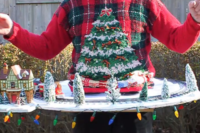Christmas jumper with working train set
