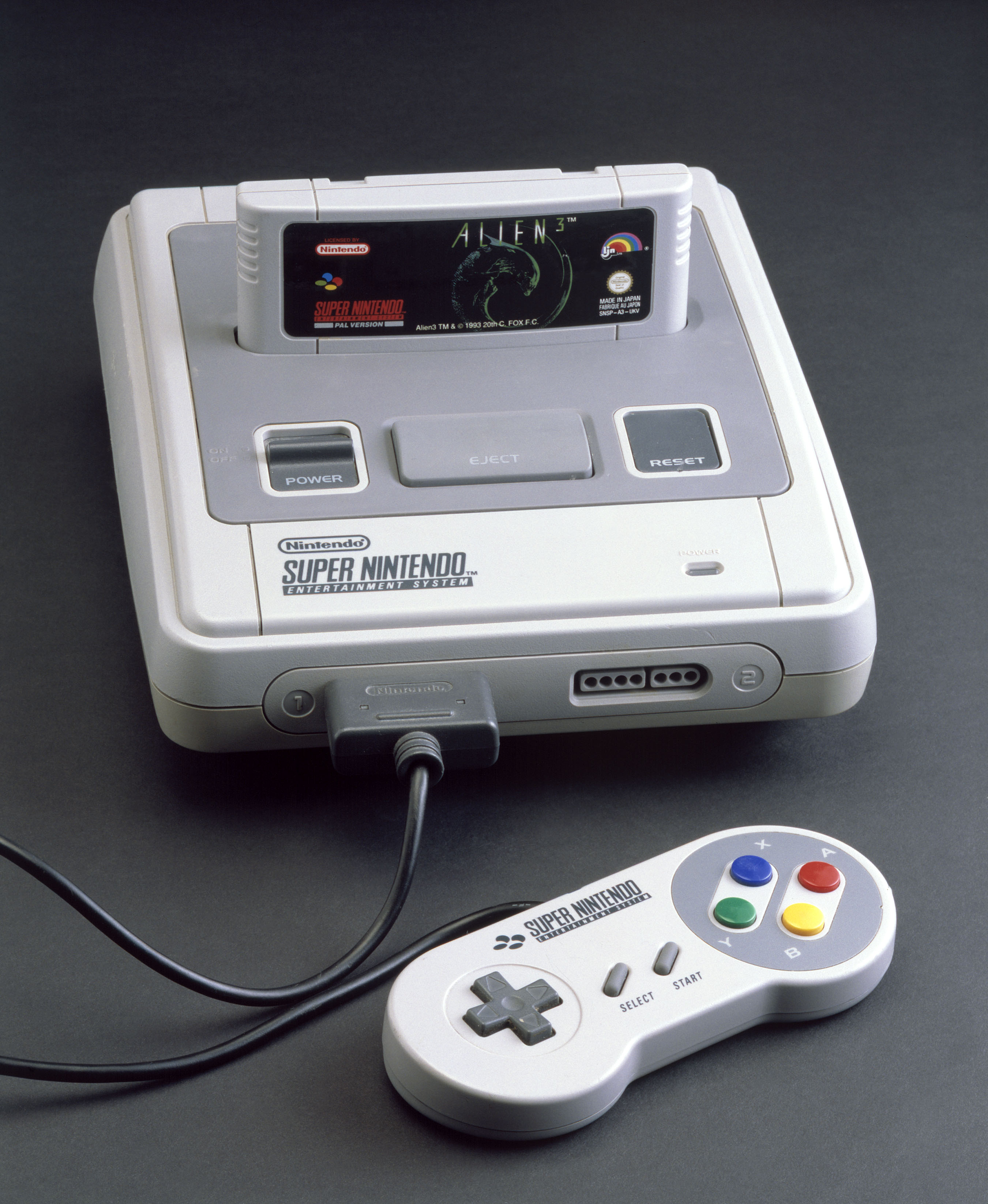 JAPAN - SEPTEMBER 04:  Super Nintendo Entertainment System, 1992. Computer games console with 'Alien 3' game cartridge and one hand-held controller made by Nintendo, Japan.  (Photo by SSPL/Getty Images)