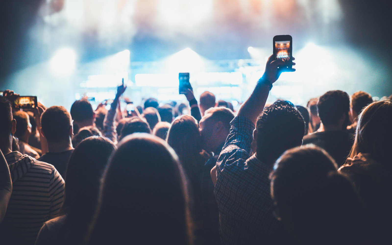 Concert audience holding mobile phones during a rock concert.
