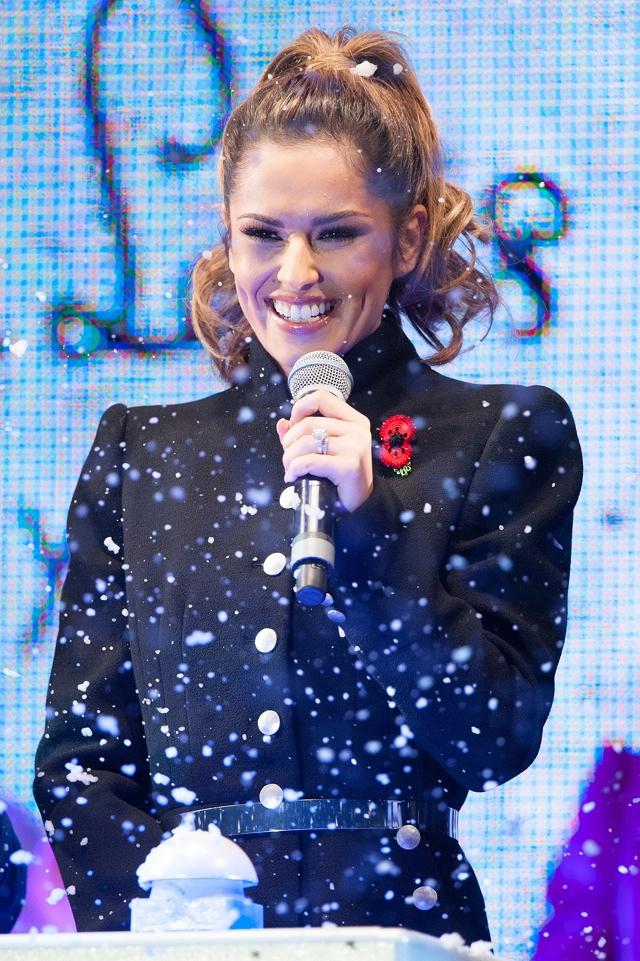 Cheryl Fernandez-Versini switches on Oxford Street Christmas lights in Alexander McQueen coat