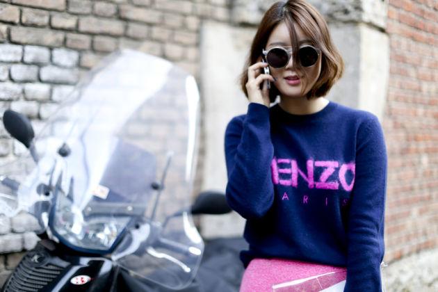 girl in kenzo sweatshirt