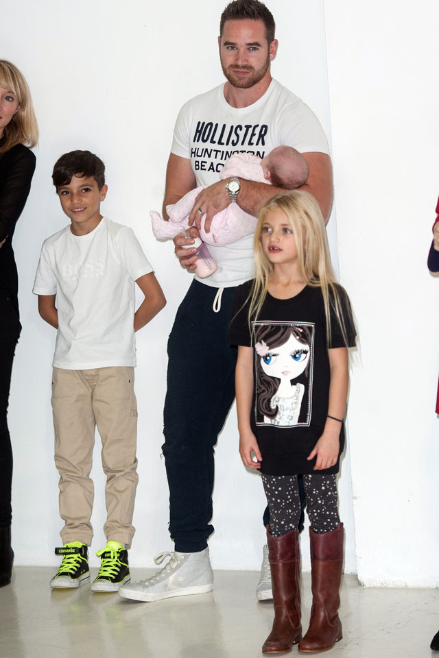 Katie Price models Christmas lingerie look in front of Junior, Princess, Jett and Bunny