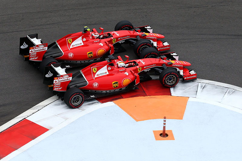Ferrari driver Sebastian Vettel passes teammate Kimi Raikkonen on the inside of Turn 1 at the 2015 Russian Grand Prix.