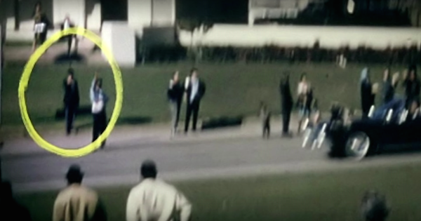 jfk conspiracy theories, jfk assassination, man with black umbrella