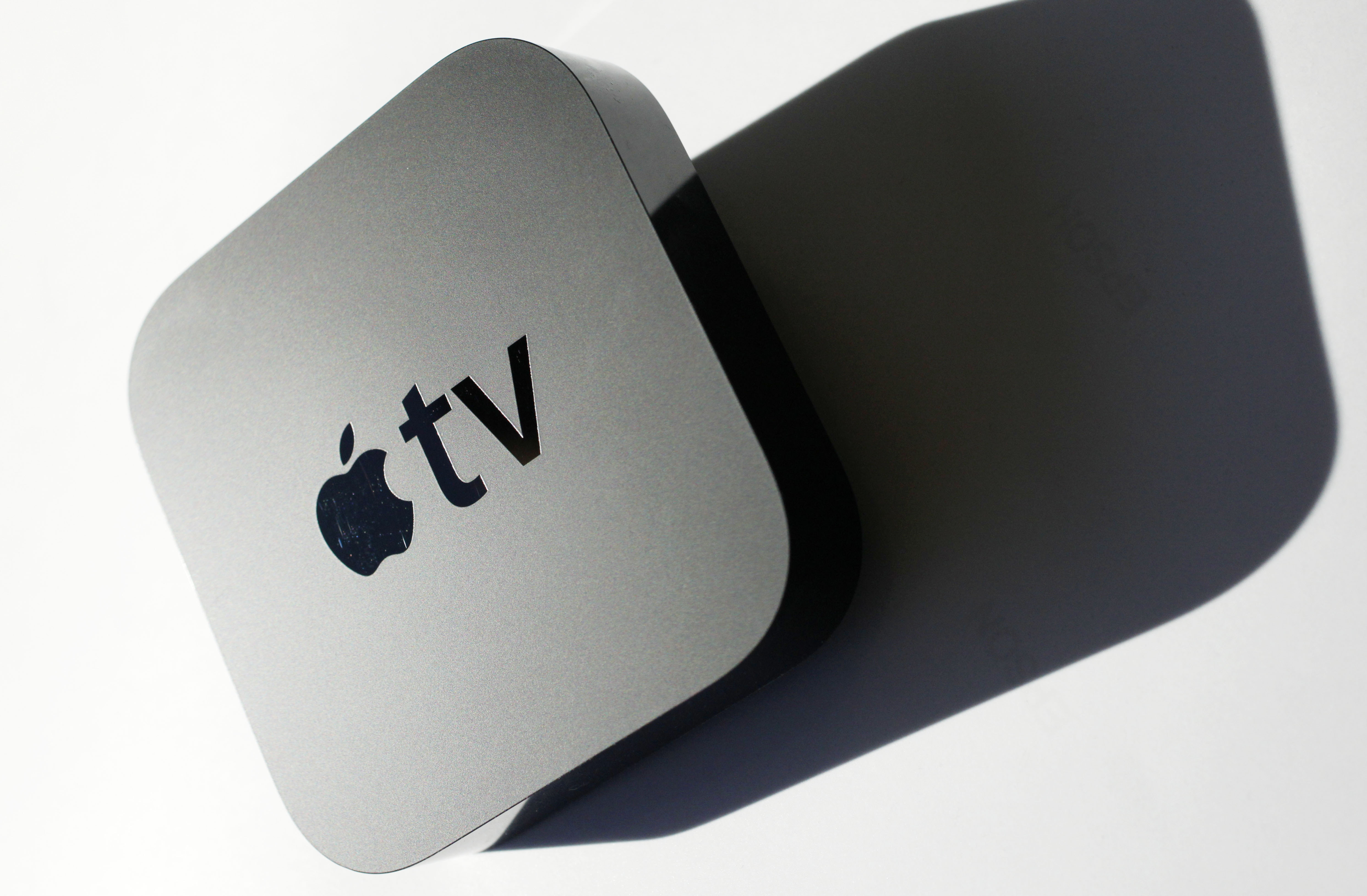 The new Apple TV converter is shown, Wednesday, Oct. 6, 2010 in New York. The device grabs movies and TV show rentals from the Internet and displays them on a TV. It does much the same thing as the older Apple TV, but is smaller and costs much less, at $99. (AP Photo/Mark Lennihan)