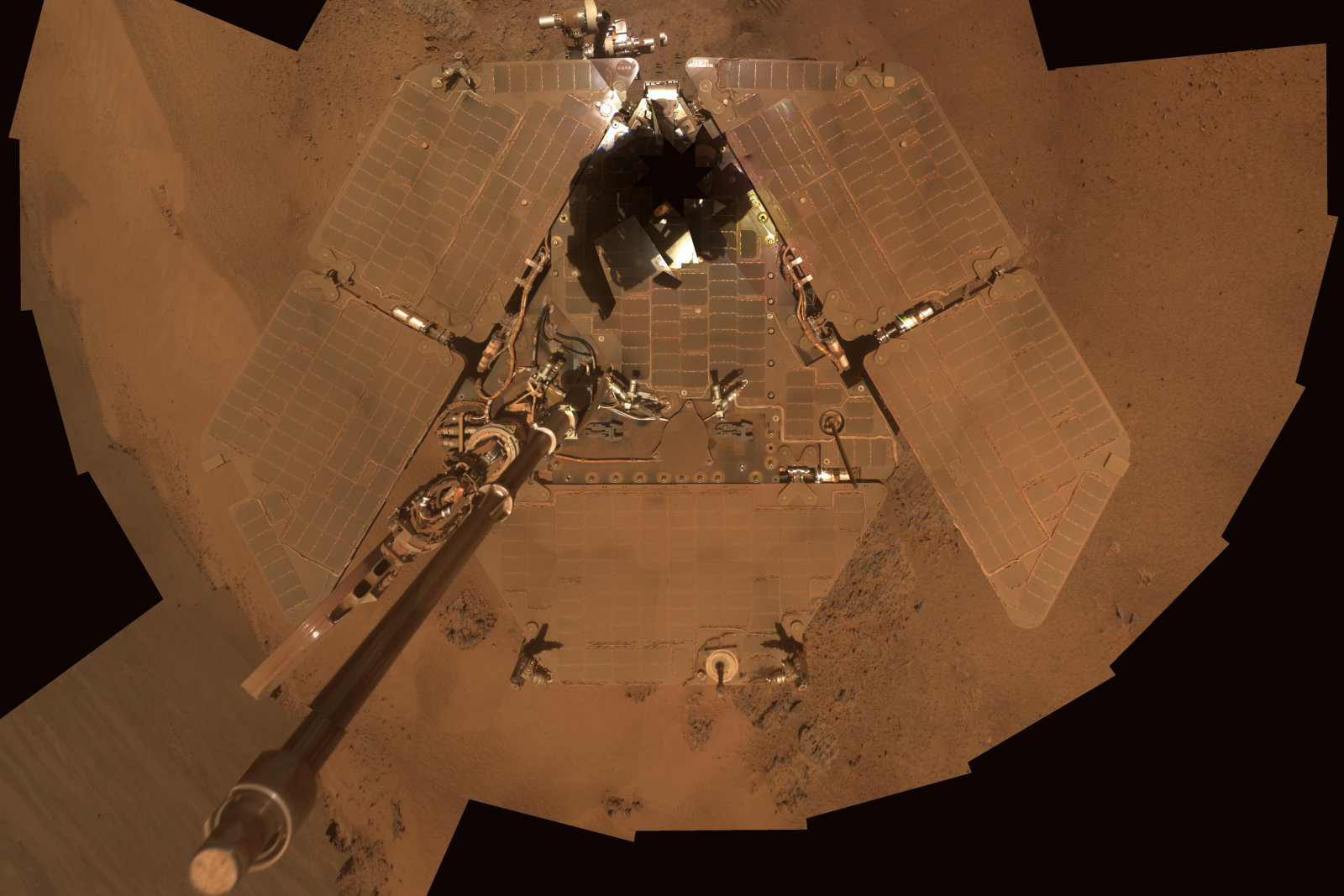 NASA handout image shows a self portrait from the Mars Exploration Rover Opportunity covered in dust as the mission approached its fifth Martian winter, December 21 to 24, 2011. This is a mosaic of images taken by Opportunity's panoramic camera (Pancam) during the 2,111th to 2,814th Martian days, or sols. The downward-looking view omits the mast on which the camera is mounted. REUTERS/NASA/JPL-Caltech/Cornell/Arizona State University/Handout (SCIENCE TECHNOLOGY ENVIRONMENT) FOR EDITORIAL USE ONLY. NOT FOR SALE FOR MARKETING OR ADVERTISING CAMPAIGNS. THIS IMAGE HAS BEEN SUPPLIED BY A THIRD PARTY. IT IS DISTRIBUTED, EXACTLY AS RECEIVED BY REUTERS, AS A SERVICE TO CLIENTS