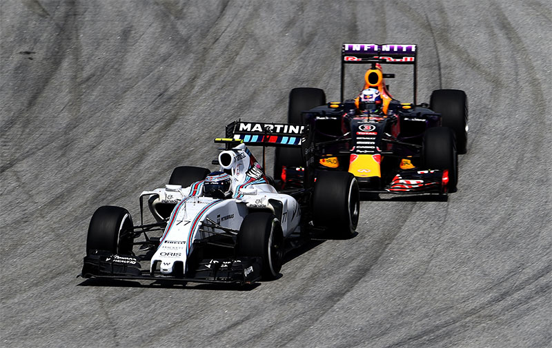 Williams races Red Bull at the 2015 Malaysian F1 Grand Prix.