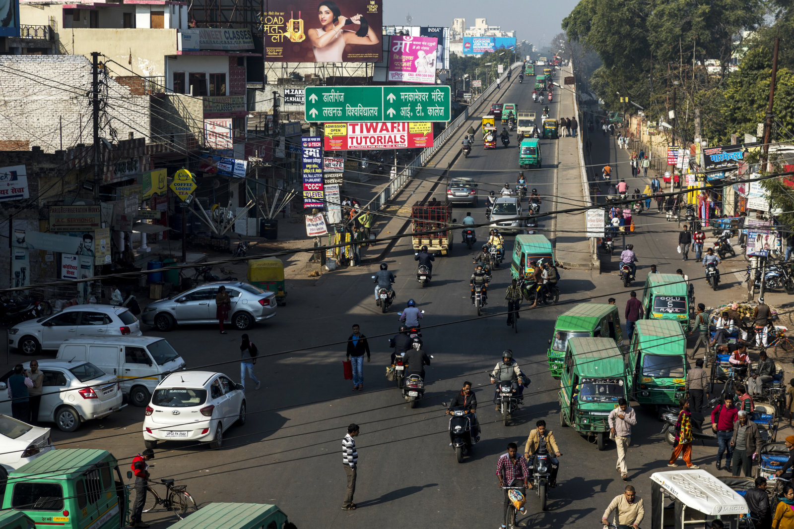 Vehicles and pedestrians pass through an intersection in Lucknow, Uttar Pradesh, India, on Tuesday, February 14, 2017. The success of the Samajwadi government's infrastructure projects has allowed them to hijack Indian Prime Minister Narendra Modi's mantra of development. Now it's possible the Bharatiya Janata Party (BJP) could lose India's most important state election,that began on Feb. 11., endangering further economic reforms and sapping Modi's momentum ahead of the 2019 national elections. Photographer: Prashanth Vishwanathan/Bloomberg via Getty Images