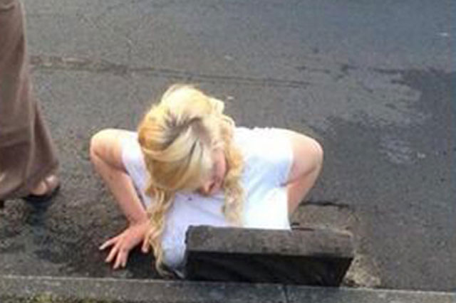 Schoolgirl gets stuck in drain trying to retrieve her phone