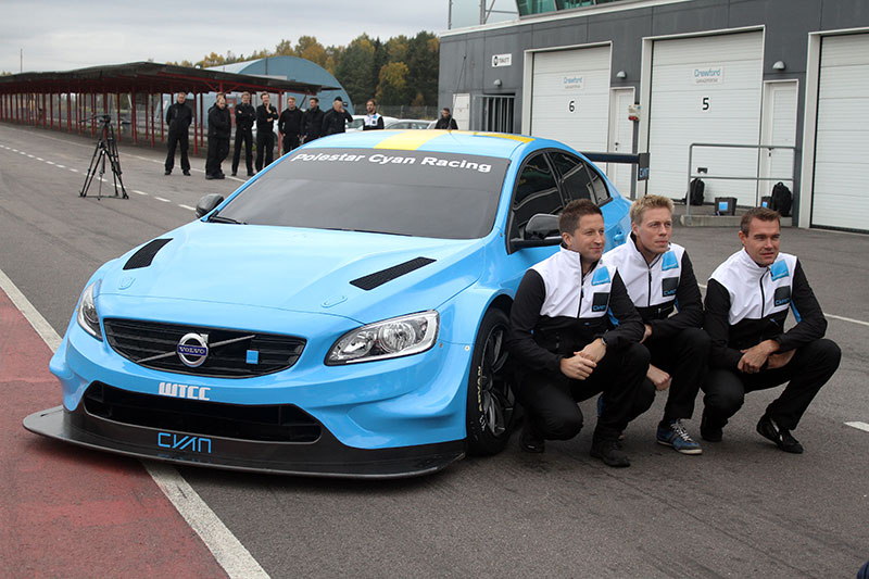 The Volvo S60 Polestar TC1 WTCC race car poses with the three development drivers for Cyan Racing.