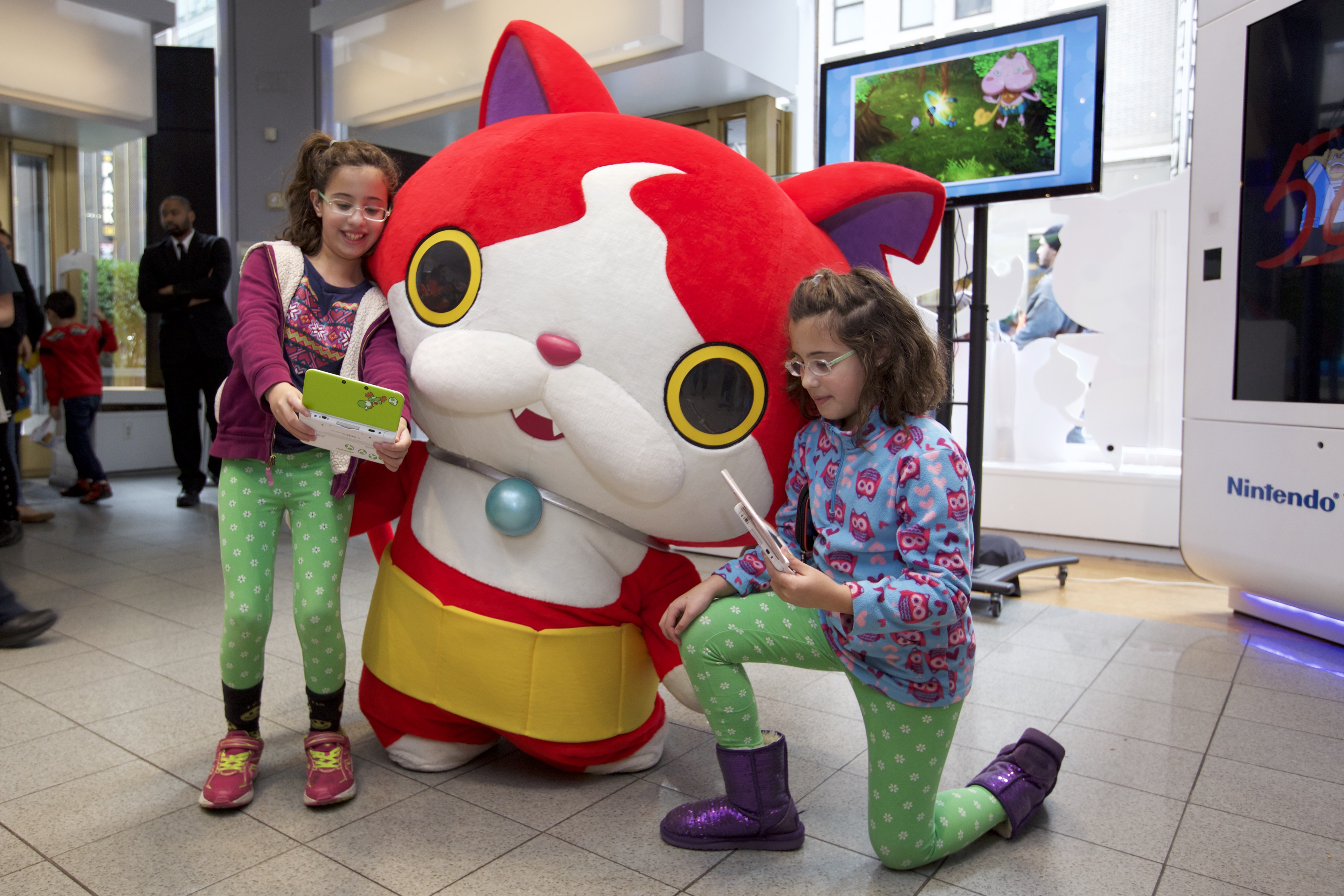 In this photo provided by Nintendo of America, fans meet and interact with YO-KAI WATCH character Jibanyan at Nintendo World in New York on Nov. 7, 2015, as part of the YO-KAI WATCH launch event. YO-KAI WATCH launched on Nov. 6, 2015 and is available exclusively for the Nintendo 3DS family of systems.